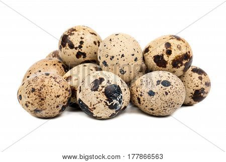 Small bunch of fresh quail eggs on white background