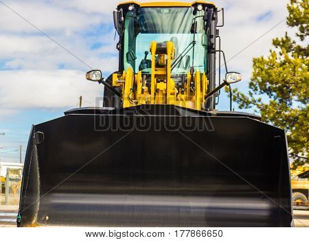 Bulldozer With enclosed Cab & Scoop Bucket Attached