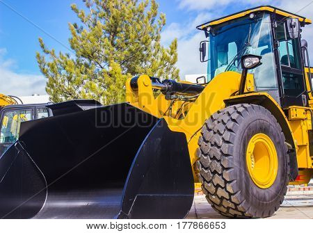 Large Bulldozer With Enclosed Cab And Scoop Bucket Attached