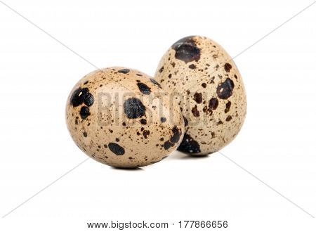 Two raw spotted quail eggs isolated on white background