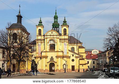 Ivano-Frankivsk Ukraine - February 02 2017: Art Museum sunny winter day. Former Collegiate Church of the Blessed Virgin Mary built in XVII century.