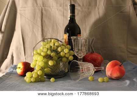 A bottle of wine and fruit. Still life
