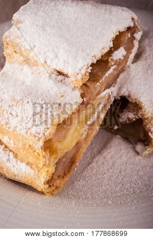 Detail Of Two Slices Of Apple Strudel With Powder Sugar