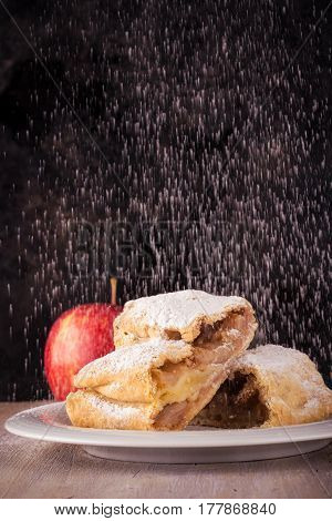 Two Slices Of Apple Strudel With Spilled Sugar