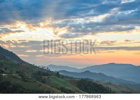 layers of mountain range and beautiful sunset sky natural environment background