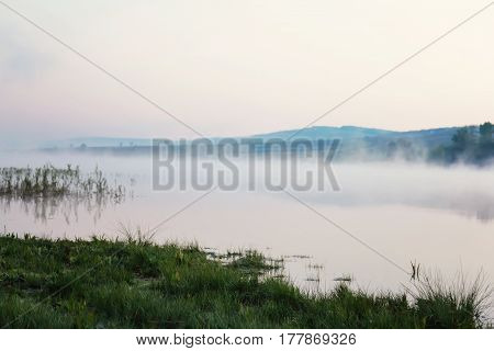 Misty lake in a cold early spring dawn calm