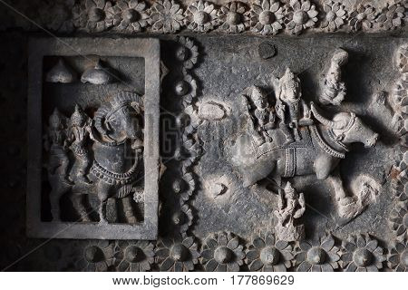 Indian gods Siva and Parvati on ceiling of 12th century temple Hoysaleswara with fantastic carvings, India. Temple was built in 1150 by king of Hoysala Empire
