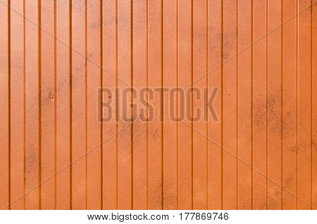Orange metal surface with vertical even stripes