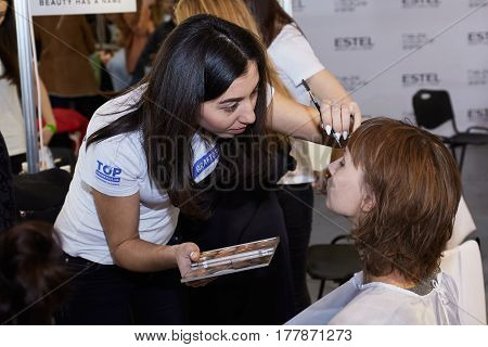 Kyiv, Ukraine - February 4, 2017: Makeup Artist At Work. Backstage Of Ukrainian Fashion Week 2017