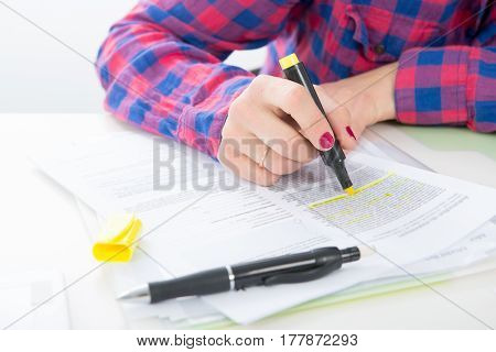 close up of hand of young woman taking notes