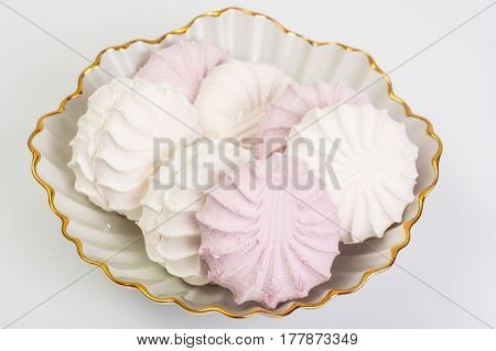Sweet delicacy of marshmallows on plate. Studio Photo