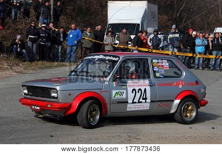 Cadibona Italy - March 02 2016 - Rally Riviera Ligure: The Fiat 127 Sport crew Dimarco-Zambelli during the first test of speed 'of the race on the heights of Savona.La car was entered by Valpolcevera racing team.