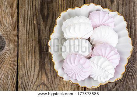 Sweet delicacy of marshmallows. on wood Studio Photo