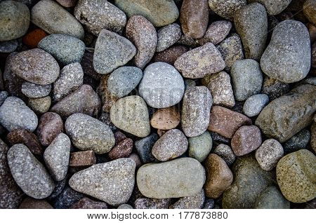 abstract background with dry round reeble stones on the beach