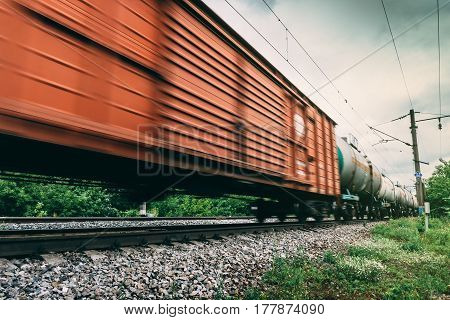 Freight train, railway wagons with motion blur effect. Transportation, railroad, toned image
