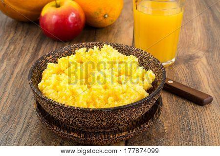 Lean food corn porridge on plate. Studio Photo