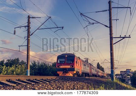 Modern passenger train on the background of blue and purple sky, copy space