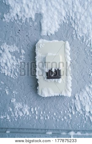 Close-up Doorbell Button cover with white snow