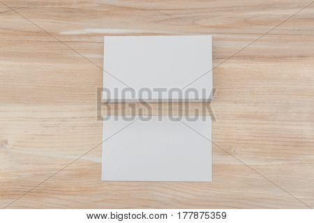 Business cards on wood table.