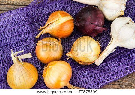 Onion in a grid on wood. Studio Photo