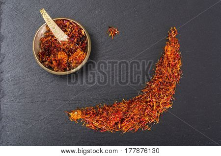 Expensive seasoning spice saffron on black. Studio Photo