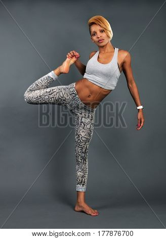 slim athletic girl doing stretching