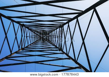 High voltage power pylons against blue sky. Transmission power line.