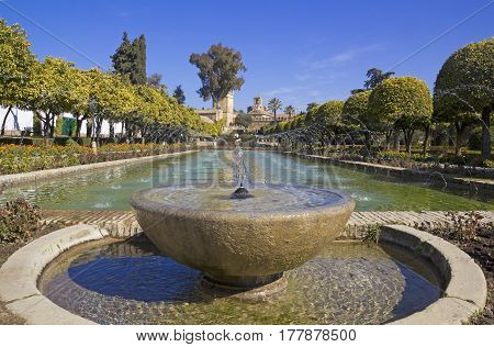 Fountain In  The Gardens Of The Alcazar De Los Reyes Cristianos In Cordoba, Andalusia Region, Spain.