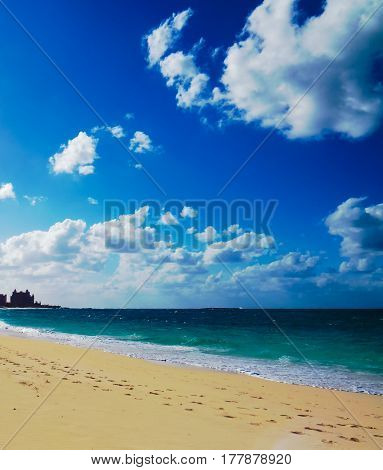 A bright vertical photo of a colorful tropical beach and the ocean. New Providence, Nassau, Bahamas.