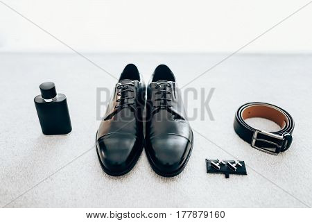 Gentleman accessories. Men's accessories: shoes , eau de cologne, cuff-links, belt. Groom's set
