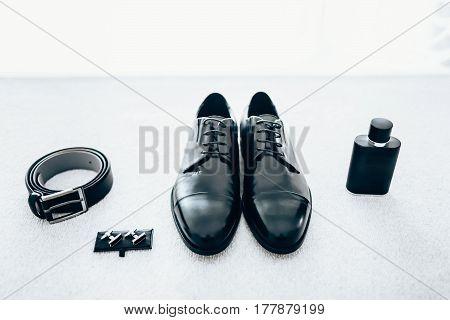 Gentleman accessories. Men's accessories: shoes , eau de cologne, cuff-links, belt. Groom's set