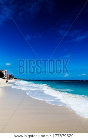 A simple vertical photo of an exotic beach and the ocean. New Providence, Nassau, Bahamas.