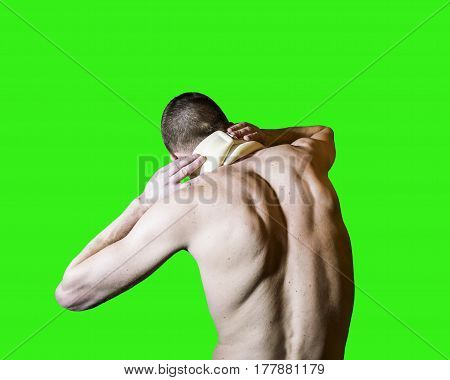 A man with a sore neck in the bus Trench is back isolated on green background