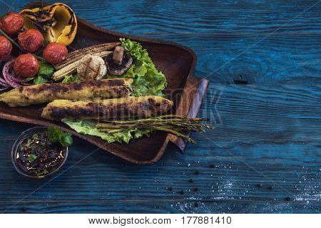 Grilled potato kebab on a blue wooden background