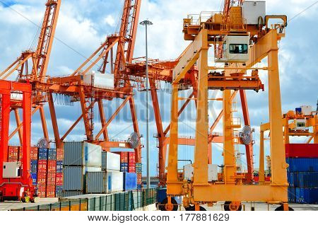 Industrial Harbor, Gantry Cranes And Container Ship. Industrial Cranes In Port Of Santa Cruz De Tene