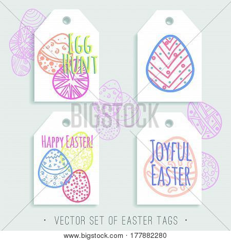 Vector set of printable Easter tags with bright eggs. Blue, red, pink, yellow, orange and green colors. Easy to edit and ready to use. Hand drawn holiday labels.