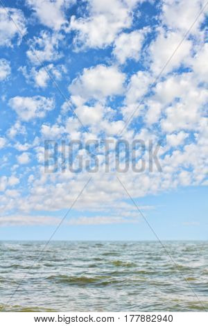 Picturesque seascape. Sea waves and blue cloudy sky.