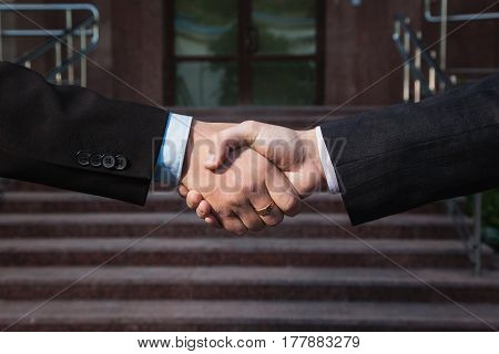 Business agreement. Handshake on background Bank. Shake hands with each other. Friendship partners. Business agreement concept