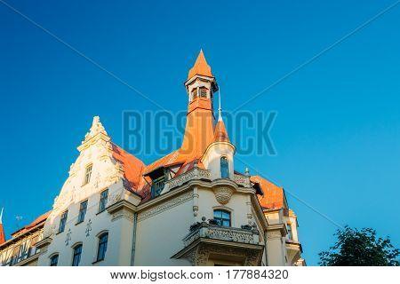 Riga, Latvia. Facade Of Old Art Nouveau Museum Building Designed By Konstantins Pekshens On 12 Alberta Street. Sunny Summer Day Under Blue Clear Sky.