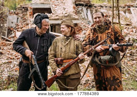 Pribor, Belarus - April 24, 2016: Re-enactors Dressed As Russian Soviet Red Army Crew Member And Soldiers Of World War II Posing with Weapons for Photography