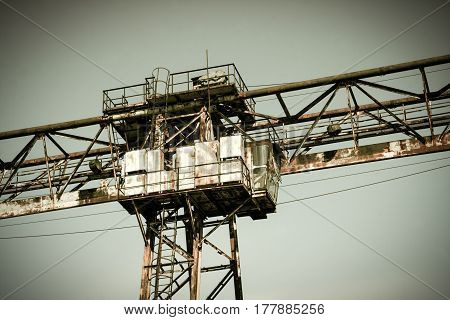 The ruins, abandoned rusty crane on rails, Ukraine, Odessa