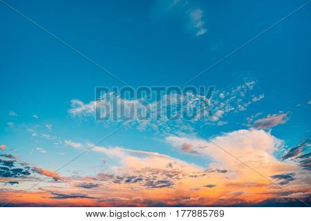 Dramatic Sunset Or Sunrise Sky With Bright Blue, Orange And Yellow Colors. Cloudy Evening Or Morning Sky