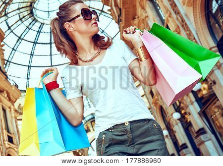 Fashion Monger With Shopping Bags In Galleria Vittorio Emanuele