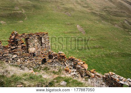 Ancient Stone Fortress On Mountain Background Near Karatkau Village, Kazbegi District, Mtskheta-Mtianeti Region, Georgia. Spring, Summer Season. Truso Gorge.