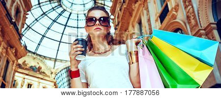 Fashion Woman With Shopping Bags And Coffee Cup In Galleria