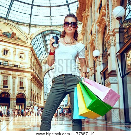 Fashion Monger In Eyeglasses With Shopping Bags And Coffee Cup