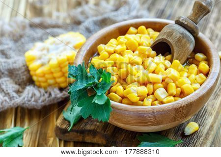 Sweet Corn And Wooden Scoop In A Bowl.