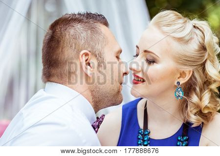 Man and woman sitting on the bed and looking at each other in the lawn in Lviv, Ukraine.