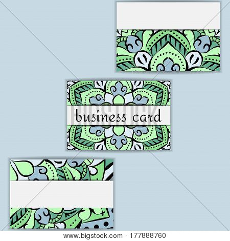 Green template business cards with oriental pattern and geometric circle element. Vintage decorative mandala pattern. Decorative floral business cards, vector template.