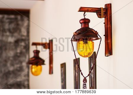 The old lamp is in a light tone. Lamp and frame of wood. Electric lamp. Vintage lamps.